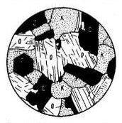 Вид под микроскопом крупнокристаллической зернистой структуры гранита.